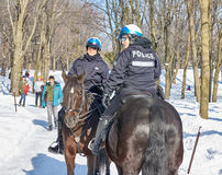 Montreal Mounted Patrol officers in Mont-Royal park. Royalty Free Stock Images