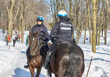 Montreal Mounted Patrol officers in Mont-Royal park. Royalty Free Stock Photos