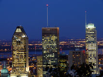 Montreal by night. Montreal downtown skyscrapers and Saint Lawrence river by night, view from Mount Royal Royalty Free Stock Photos