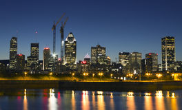 Montreal by night. Montreal skyline as seen from thre Peel bassin with reflexion in the water Royalty Free Stock Photos