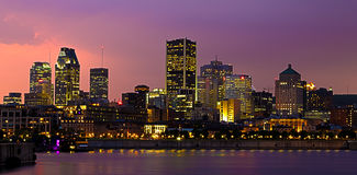 Montreal by night. Skyline of Montreal downtown at night as a lightning storm is coming Royalty Free Stock Images