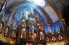 Montreal Notre-Dame Basilica. Sunshine on the altar of Montreal Notre-Dame Basilica (French: Basilique Notre-Dame de Montreal), Montreal, Quebec, Canada Stock Photos