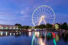 Montreal Observation Wheel. Montreal, Canada - 13 July 2017: The Montreal Observation Wheel Grande Roue de Montreal in the Old Port of Montreal at night royalty free stock images