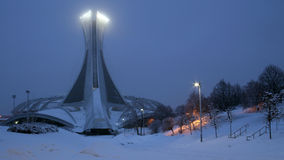 Montreal Olympic Parc under Snow at Night Stock Image