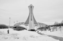 Montreal Olympic Stadium. MONTREAL,CANADA - MARCH.3.The Montreal Olympic Stadium and tower on March 3 , 2013. It's the tallest inclined tower in the world.Tour Royalty Free Stock Photo