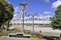 The Montreal Olympic Stadium. MONTREAL CANADA MAY 15: The Montreal Olympic Stadium and tower on May 15 2013. It's the tallest inclined tower in the world.Tour Royalty Free Stock Image
