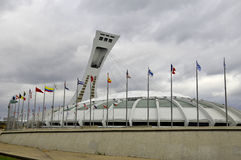 The Montreal Olympic Stadium. MONTREAL CANADA MAY 15: The Montreal Olympic Stadium and tower on May 15 2013. It's the tallest inclined tower in the world.Tour Royalty Free Stock Photo