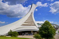 The Montreal Olympic Stadium. MONTREAL CANADA MAY 15: The Montreal Olympic Stadium and tower on May 15 2013. It's the tallest inclined tower in the world.Tour Stock Photos