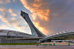 Montreal Olympic Stadium. The Montreal Olympic Stadium and tower at sunset. It's the tallest inclined tower in the world.Tour Olympique stands 175 meters tall Royalty Free Stock Image