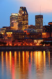 Montreal over river at sunset Stock Photography