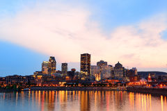 Montreal over river at sunset Stock Photos