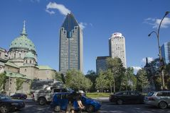 Montreal, Quebec, Canada - 18 July 2016 - Buildngs and heavy traffic in downtown in Montreal in summertime. Canadian lifestyle wi royalty free stock images