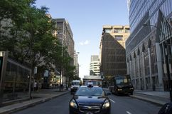 Montreal, Quebec, Canada - 18 July 2016 - Generic street in down. Montreal, Quebec, Canada - 18 July 2016 - Generic street and taxi in the front in downtown in stock photography