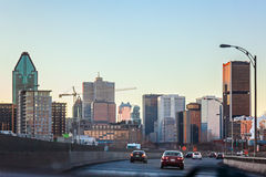 Montreal, Quebec, Canada - March 11, 2016: Evening in downtown Montreal city, early sunset. Road view. Royalty Free Stock Photos