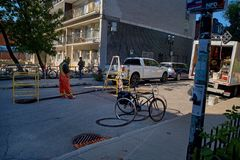 Free Montreal, Quebec, Canada September 25, 2018: Worker With Safety Vest On And Orange Cone At Manhole On Residential Street Royalty Free Stock Image - 141389536