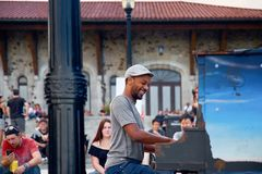 Montreal, Quebec, Canada, September 01, 2018: an impromptu performance of a guy at the piano for people, plays on the observation. Deck of Condiaronc in front royalty free stock photo