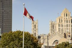 Basilica of Notre Dame in Montreal, Canada skyline. Montreal, Quebec, Canada skyline with towers of Basilica of Notre Dame next to modern high rise buildings and stock photos