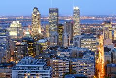 Montreal's downtown by night. This image was taken from the Parc du Mont-Royal and show Montreal, Canada illuminated at night Royalty Free Stock Photo