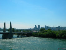 Montreal skyline. Scenic view of Montreal city skyline with river in foreground, Quebec, Canada Royalty Free Stock Photos