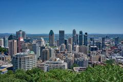 Montreal Canada Skyline Day. Montreal Skyline of the city urban from the top of Mont Royal overlooking the buildings in the modern country of Canada royalty free stock images