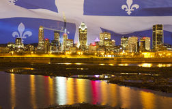 Montreal skyline with Quebec flag Royalty Free Stock Images