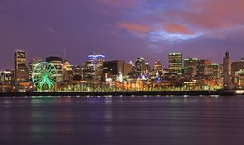 Montreal skyline and Saint Lawrence River at dusk, Canada. Montreal skyline illuminated at night at dusk in Quebec, Canada royalty free stock image