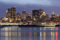 Montreal skyline and Saint Lawrence River at dusk stock photography