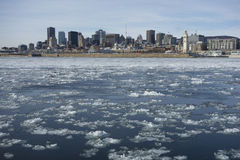 Montreal Skyline in winter. With chunks of ice floating on the Saint-lauwrence stock image