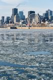 Montreal Skyline in winter 2018. Montreal Skyline in winter, with chunks of ice floating on the Saint-lawrence 2018 royalty free stock photo