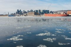 Montreal Skyline in winter 2018. Montreal Skyline in winter, with chunks of ice floating on the Saint-lawrence 2018 stock images