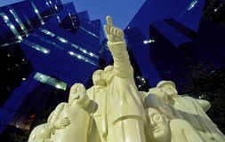 Montreal statue. The Illuminated Crowd by artist Raymond Mason at the entrance to the BNP Tower - Laurentian Bank Tower in downtown Montreal, Quebec, Canada Royalty Free Stock Images