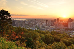 Montreal sunrise viewed from Mont Royal with city skyline in the stock images