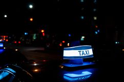 Montreal taxi at night in the street. Picture of Montreal city taxi glow sign at night time stock image