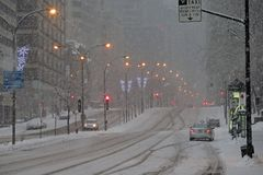 Montreal under snow 2. René-Lévesque Boulevard, in downtown Montreal, in a snowstorm. Photo taken early morning royalty free stock photography