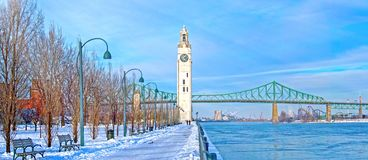Montreal in winter, Canada. St. Lawrence River with Big Ben in Old Montreal, Quebec, Canada and Jacques-Cartier Bridge in background, winter season stock photos