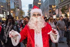 Montreal Zombie Walk 2017. Montreal, Canada - October 28, 2017: Undead Santa Claus taking part in the Zombie Walk in Montreal Downtown Stock Photography