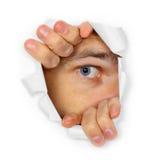 Montres d'homme par un trou Image libre de droits