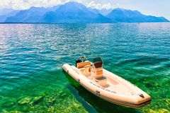 Montreux, Switzerland - August 28, 2016: Boat on Geneva Lake in Montreux, Swiss Riviera. Montreux, Switzerland - August 28, 2016: Boat on Geneva Lake in Montreux royalty free stock photography