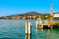 Montreux, Switzerland - August 28, 2016: Pier at Geneva Lake in Montreux, Swiss Riviera. Montreux, Switzerland - August 28, 2016: Pier at Geneva Lake in Montreux royalty free stock photography