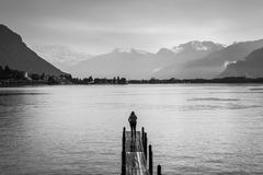 Travel woman standing on the wood bridge, Lake Geneva royalty free stock photos
