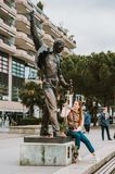 MONTREUX, SWITZERLAND - MAY 10 , 2018. Young woman tourist visiting the statue of singer Freddie Mercury. MONTREUX, SWITZERLAND - MAY 10 , 2018. Young woman stock photos