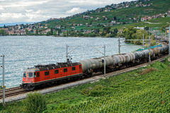 MONTREUX/SWITZERLAND - SEPTEMBER 14 : Freight Train Passing along Lake Geneva near Montreux in Switzerland on September 14, 2015 royalty free stock photos