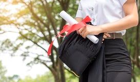 Montrez diplômée après gradué Photo libre de droits