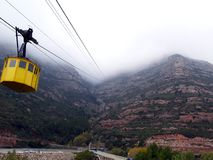 Montserrat Aeri Barcelona Spain. Cable car to go up to Montserrat, Spain which mountain top covered by thick clouds Royalty Free Stock Image