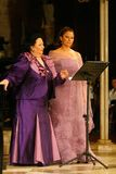 Montserrat Caballe and daughter on scene vertical. Montserrat Caballe and his daughter, Spanish operatic soprano singers during a live performance in the island royalty free stock image