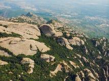Montserrat, Catalonia, Spain. Top View Of Hillside Cave Santa Cova De Montserrat Or Holy Cave Of Montserrat In Summer stock image