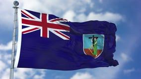 Montserrat Flag in een Blauwe Hemel Stock Fotografie