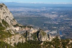Montserrat Monastery is spectacularly Benedictine Abbey in the mountains near Barcelona, Catalonia,Spain.Montserrat.Panorama of th Stock Photos
