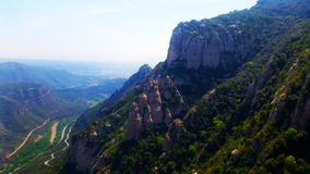 Montserrat multi-peaked rocky Barcelona. Montserrat  is a multi-peaked rocky range located near the city of Barcelona, in Catalonia Royalty Free Stock Photos