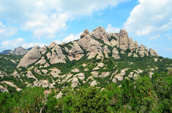 Montserrat needles. Montserrat is a multi-peaked mountain located near the city of Barcelona, in Catalonia.  Montserrat literally means saw mountain in Catalan Stock Image